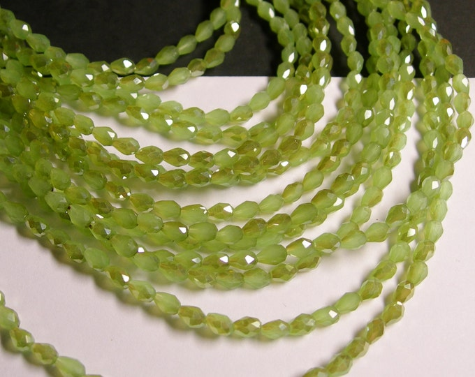 Faceted teardrop crystal beads - 100 pcs - 3mm x 5mm -  ab finish - lime green - CLGD26