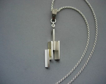 V wave silver and 18ct gold pendent