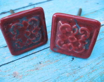 2 Red Ceramic Square Knobs Distressed With Raised Scroll Patterns B-22