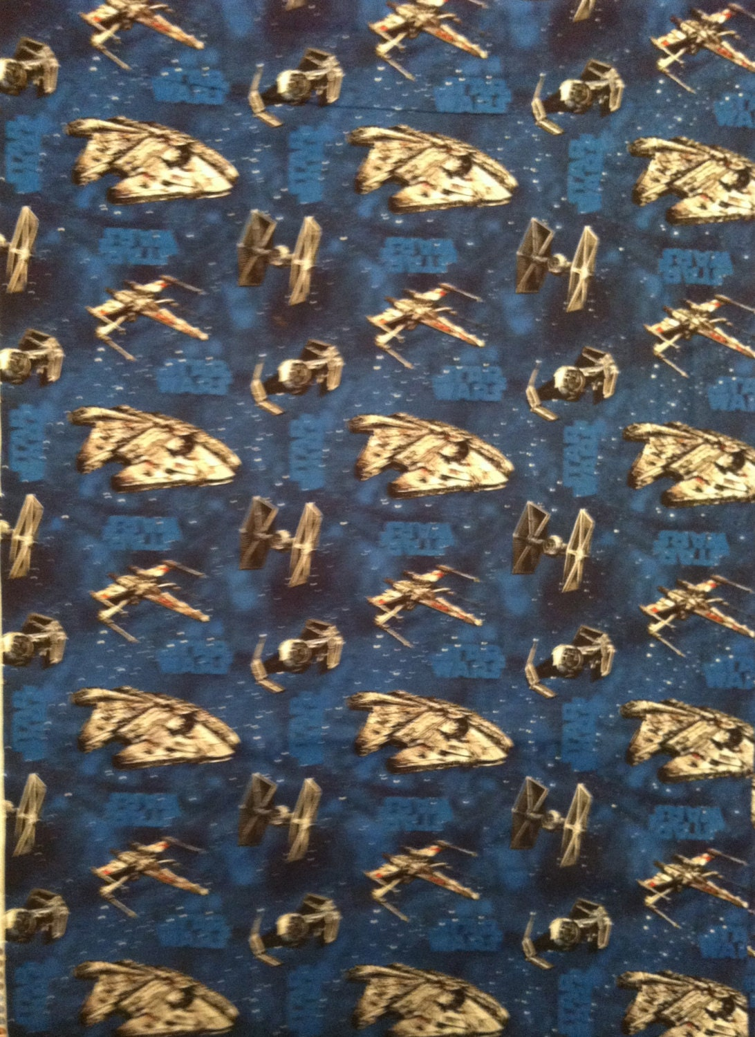 A star wars action in space tossed fabric by the yard free for Space fabric by the yard