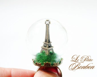 Eiffel Tower in a glass globe ring