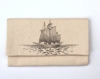 tri-fold wallet with hand drawn single ship on the sea item number 306