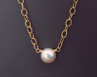 Fancy gold chain and white freshwater pearl button necklace