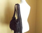 black leather handbag, shoulder purse, flower, rose, fringe and ruffle by Tuscada. Made to order.