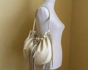 cream vanilla leather handbag, shoulder purse,  with flower,  fringe and ruffle by Tuscada. Ready to ship.