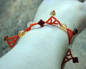 Orange, red, and clear triangle anklet