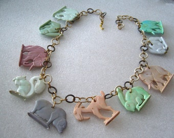Vintage Cracker Jack early plastic charms 1940's necklace - rabbits, elephants, squirrel and more ...