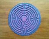 Chartres Finger Labyrinth with raised purple path and purple swirled background