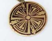 Dark coloured Haven Guard brass circle pendant