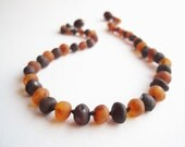 Maximum Effective Raw Unpolished Baltic Amber teething necklace for your baby handmade knotted . Cognac and Cherry colour.
