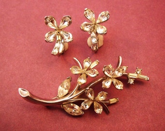 Trifari brooch and earring set delicate silver tone flower and rhinestones.