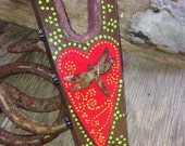 Hand Painted Boot Jack and rusted tin dragonfly and red ribbon sides
