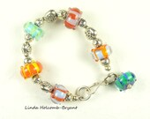 Bracelet of Bright Striped Lampwork Beads