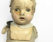 1940s creepy composition doll with blue eyes advanced decomposition