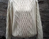 Cream fisherman's aran style cable sweater.Trellis and diamond cables. Hand knitted in pure British wool. 100 % Bluefaced Leicester yarn.