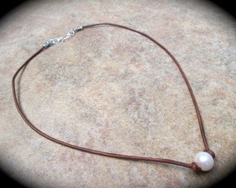 Leather and  Pearl necklace with sterling silver clasp and single Pearl your choice black or brown leather cord and freshwater pearl