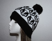 Black and White Pompom Beanie Hat with Badgers