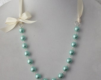 Turquoise Pearl and Ivory Ribbon Bow Necklace