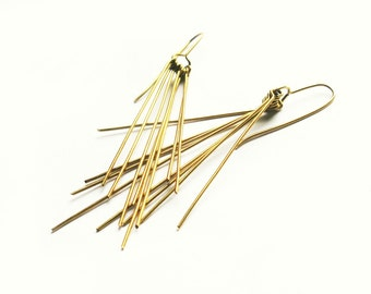 Simple golden dangle earrings made of brass Feathers minimalist jewelry