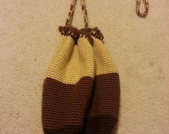 Brown circle drawstring bag