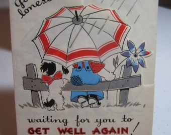 Adorable unused 1930's-40's art deco die cut silver gilded get well card boy, girl and dog sitting on fence post in the rain with umbrella