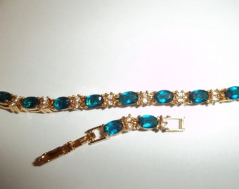 gold plated avon link and extender turquoise rhinstone bracelet