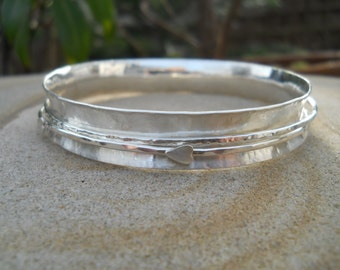 Sterling silver spinner bangle with two spinners