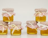 30 mini 2 oz. mason honey jars with pink gingham fabric that is so cute for a rustic pink barn wedding, bridal shower or baby shower!