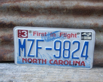 License Plate Old License Plate 2001 Craft Supply Supplies Numbers North Carolina First in Flight Blue Man Cave Sign Garage Sign Wall Hanger