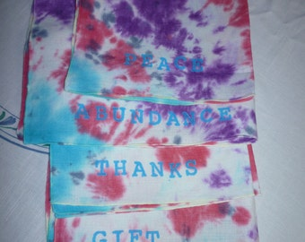 4 Hand Stamped and tie-dyed Vintage Linen Napkins in purple, turquoise and red.navy with Inspirational words added.They save paper products.