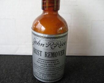Vintage John R Rice Rust Remover in brown bottle