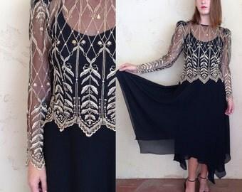 black maxi dress w/ golden embroidered mesh overlay & jagged hem