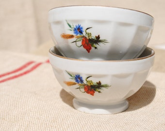 Pair of small Vintage French white café au lait coffee bowls - decorated with poppies and cornflowers.