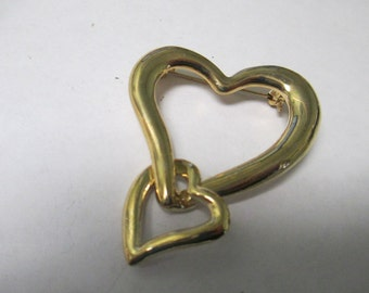 Vintage gold toned double heart brooch not signed used