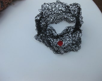 crochet metal brace with red rose