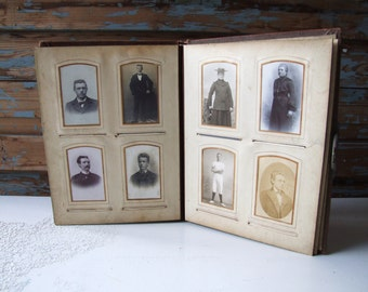 Big antique photo album filled with photos cabinet cards