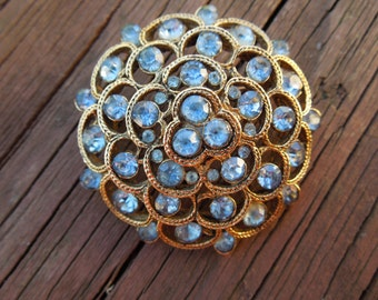 Vintage Gold Tone Brooch With Blue Rhinestones.  Beautiful Item.