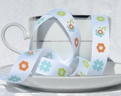 "Lime, Blue, and Orange Flowers on White Grosgrain Riley Blake Designer Ribbon  5/8"" Wide -3 yards"