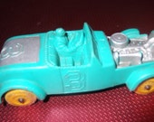 Vintage Auburn automobile teal green rubber with rubber wheels and driver, very good condition