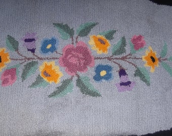 Vintage, antique large hooked rug, beautiful, floral pattern with many beautiful colors size 27 x 51 L a beautiful addition to your home