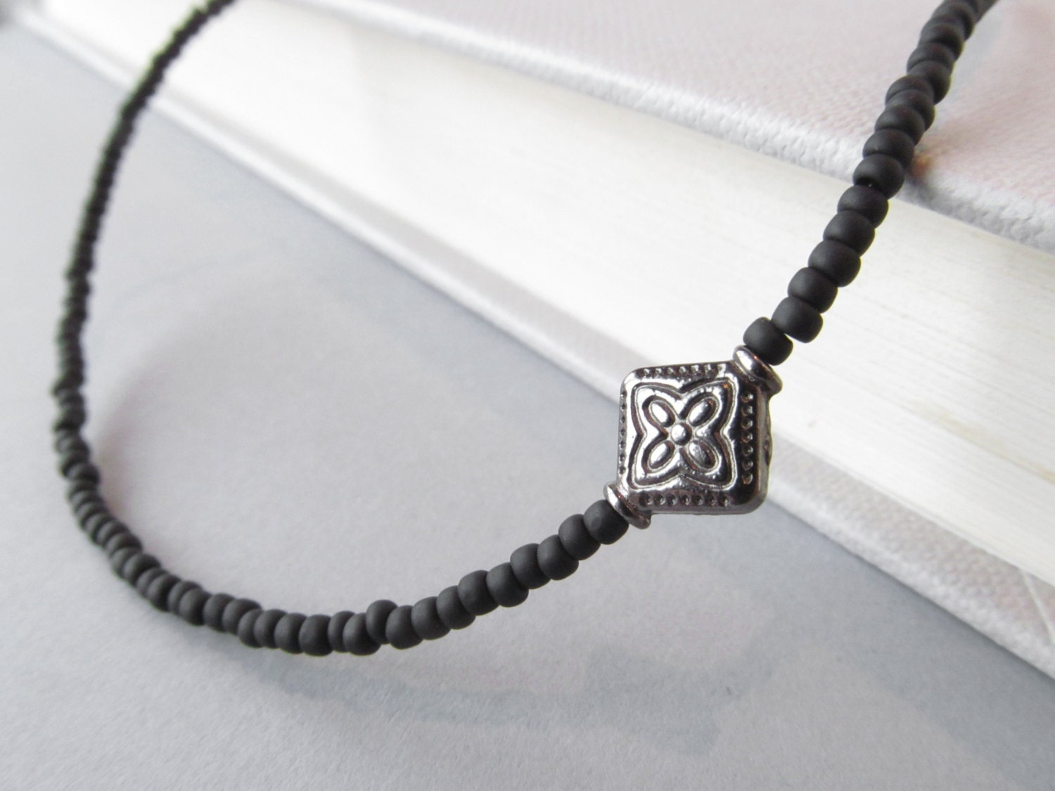 beaded black eyeglass chain with gunmetal accent by