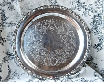 Vintage silver plate tray...round WM Rogers tray...571.