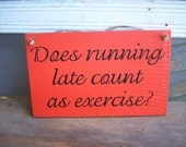 Does running late count as exercise - wood sign