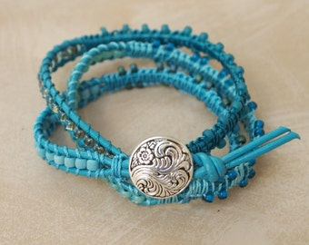 triple wrap turquoise beadwork bracelet on leather cord with silver button clasp