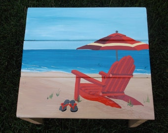 Adirondack Chair Umbrella And Flip Flop On The Beach Hand