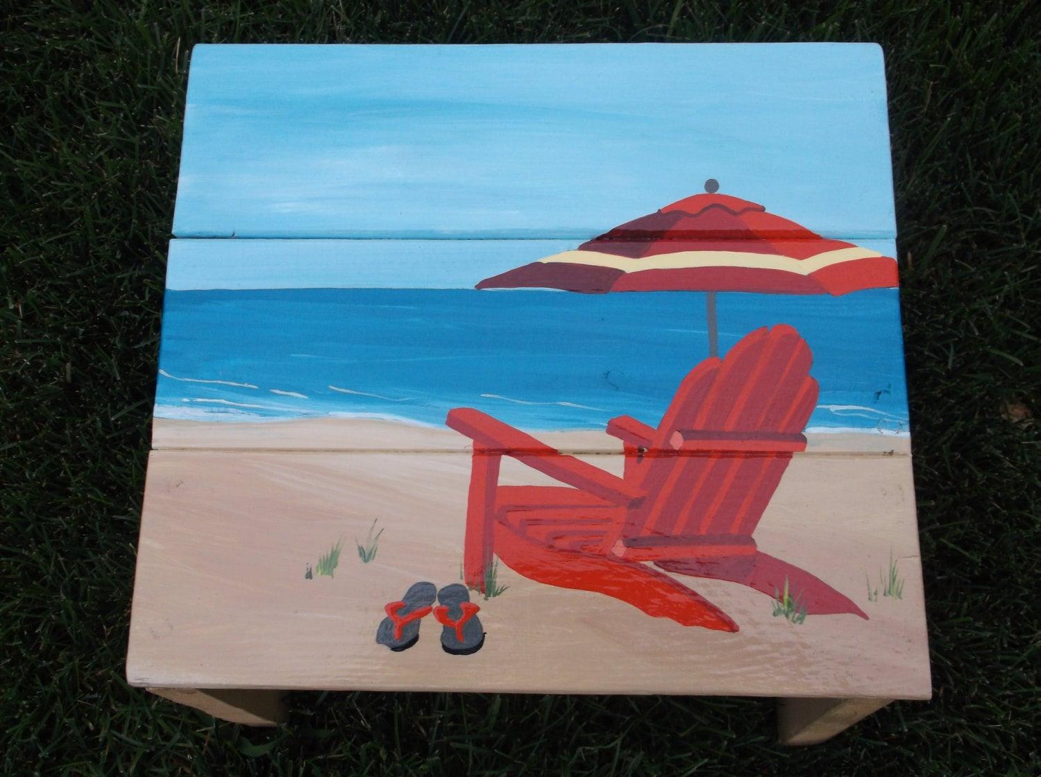 Adirondack Chair Umbrella and Flip Flop on the Beach Hand