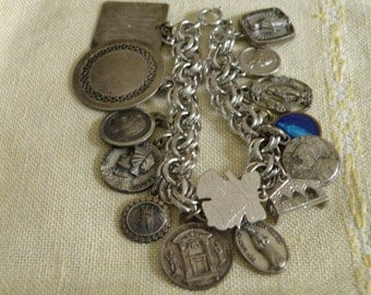 Vintage Sterling Silver Charm Bracelet - 14 charms and 7 1/4 inch in length