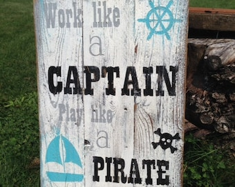 Work like a CAPTAIN play like a PIRATE rustic painted wood sign