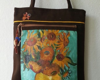 A handmade purse/bag with manually painted sunflowers.