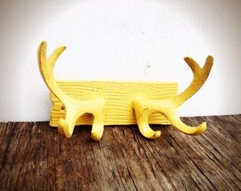 BOLD rustic cast iron deer antlers wall hook // coat rack towel hooks // golden yellow // shabby cabin boho chic // tribal bohemian storage